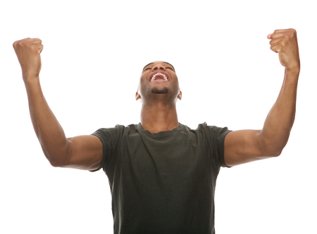 Foto de Portrait of a cheerful young man shouting with arms raised in success - Imagen libre de derechos