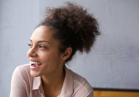 Photo for Profile portrait of a beautiful young african american woman laughing - Royalty Free Image