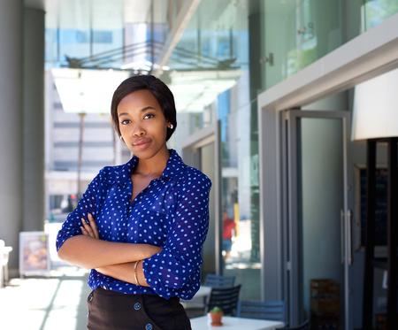 Photo pour Portrait of a female office worker standing outside business building - image libre de droit