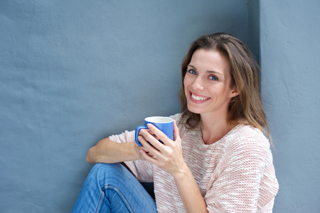 Foto für Portrait of a beautiful woman enjoying a drink of a coffee - Lizenzfreies Bild