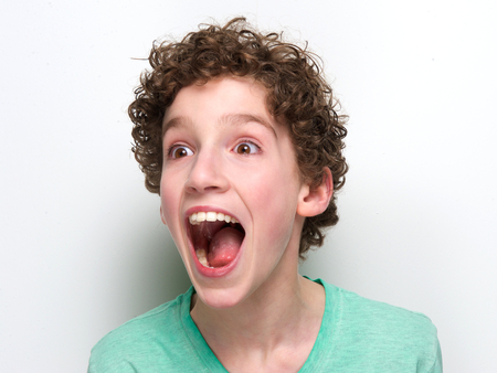 Photo for Close up portrait of a boy with mouth open having a surprised expression - Royalty Free Image