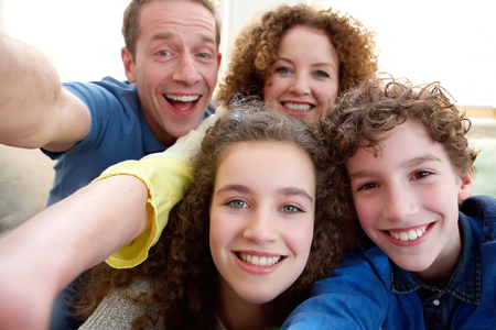 Photo for Portrait of a happy family taking a selfie together - Royalty Free Image