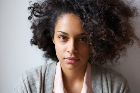 Photo for Close up portrait of an attractive young african american woman looking at camera - Royalty Free Image