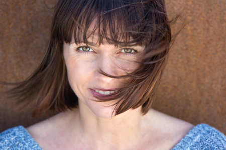 Foto per Close up portrait of a mature woman with hair blowing in wind - Immagine Royalty Free
