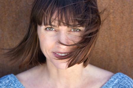 Foto für Close up portrait of a mature woman with hair blowing in wind - Lizenzfreies Bild