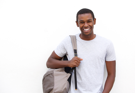 Foto de Portrait of a college student smiling with bag on white background - Imagen libre de derechos