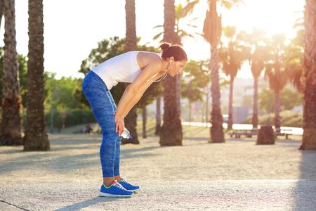 Photo pour Portrait of a tired woman resting after workout exercise - image libre de droit