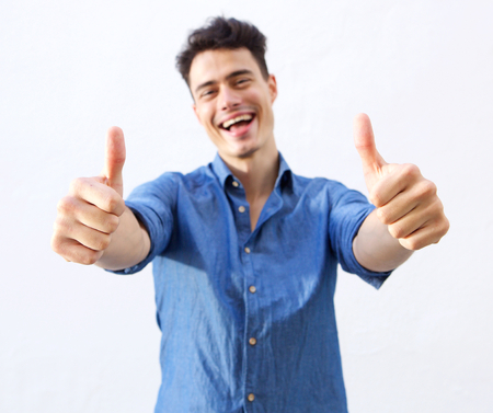 Photo for Portrait of a happy guy with thumbs up hand sign - Royalty Free Image
