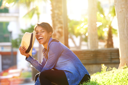 Photo for Side portrait of a carefree young woman laughing outside - Royalty Free Image
