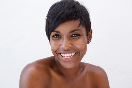 Photo pour Close up portrait of an african american beauty smiling against white background - image libre de droit