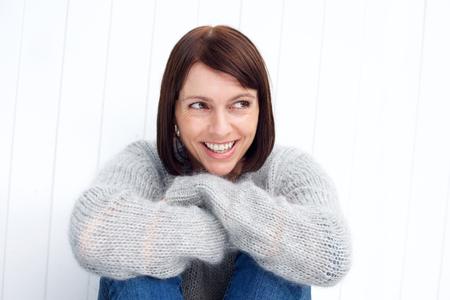 Foto für Close up portrait of a beautiful older woman smiling against white background - Lizenzfreies Bild