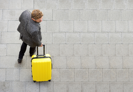 Photo for Top view travel man walking with suitcase - Royalty Free Image