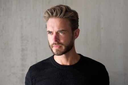 Foto de Close up horizontal portrait of a male fashion model with beard staring - Imagen libre de derechos