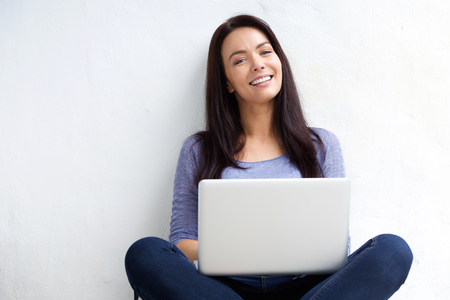 Photo pour Portrait of a relaxed female student using laptop - image libre de droit