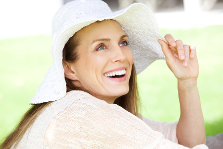 Photo for Close up portrait of a natural woman smiling with hat - Royalty Free Image