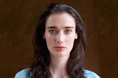 Photo pour Close up portrait of attractive young woman with long hair - image libre de droit