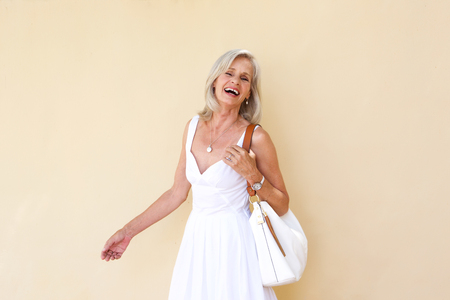 Foto per Portrait of cheerful older woman in summer dress - Immagine Royalty Free