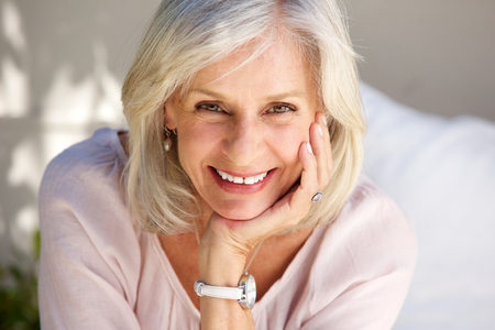 Foto de Close up portrait of mature woman smiling outside - Imagen libre de derechos