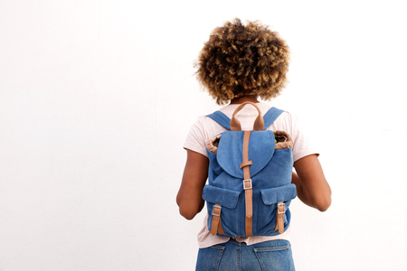 Photo for Rear view of african female student with bag against white background - Royalty Free Image