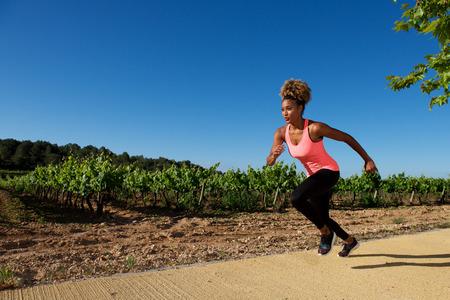 Photo pour Portrait of fit woman running fast outdoors - image libre de droit