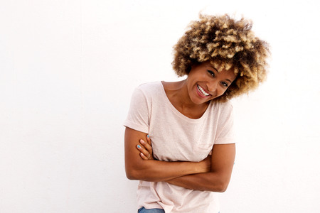 Photo pour Portrait of cheerful african woman with arms crossed isolated on white background - image libre de droit