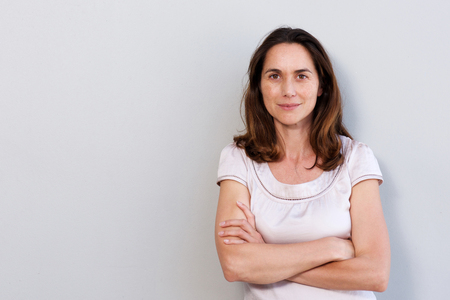 Photo for Portrait of attractive older woman against white wall - Royalty Free Image