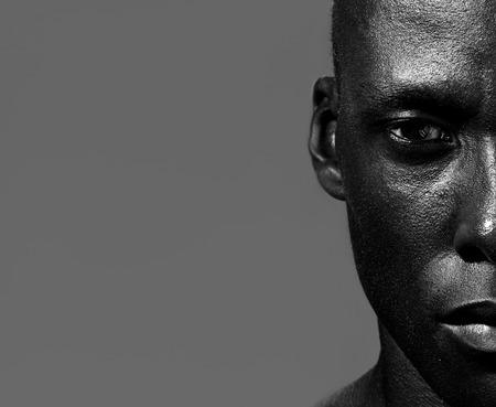 Foto de Half face portrait of handsome african american man staring - Imagen libre de derechos