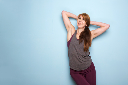 Photo for Portrait of fit mature caucasian lady with hands behind head looking away and smiling - Royalty Free Image