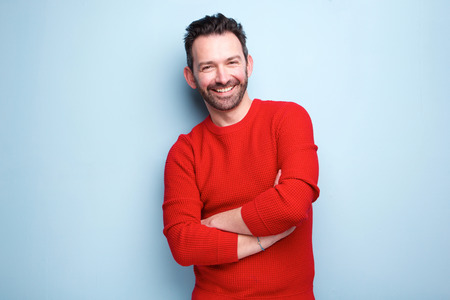 Photo for Portrait of cheerful man with beard posing against blue background - Royalty Free Image