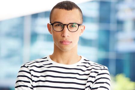 Foto de Close up horizontal portrait of handsome young man with glasses - Imagen libre de derechos