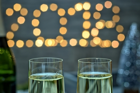 Photo for New year concept - champagne glasses on a blurry gold background new year. - Royalty Free Image