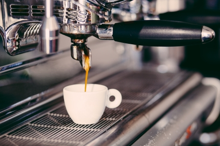Foto de Professional coffee machine making espresso in a cafe - Imagen libre de derechos