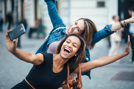 Photo for Multi ethnic Friends having fun in city taking selfie - Royalty Free Image