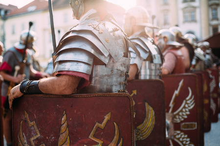 Foto de Roman soldiers legionaries standing at ease during reeinactment - Imagen libre de derechos