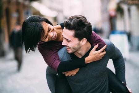Photo pour Interracial couple in love having fun in the city - image libre de droit