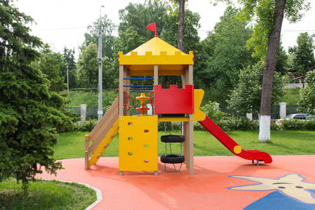 Photo for Modern Playground Equipment. Modern Colorful kids playground on yard in the park. image for background of playground, activities at public park. - Royalty Free Image