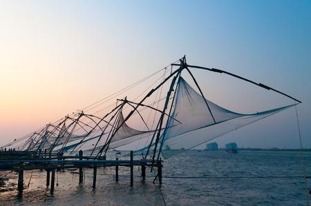 Foto de Chinese Fishing nets at sunset. Fort Kochi. Kerala. India - Imagen libre de derechos