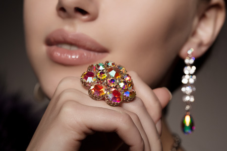Photo pour Diamond. Brilliant. Antique old vintage earrings and ring. Jewelry on her finger at the girl close-up on a - image libre de droit