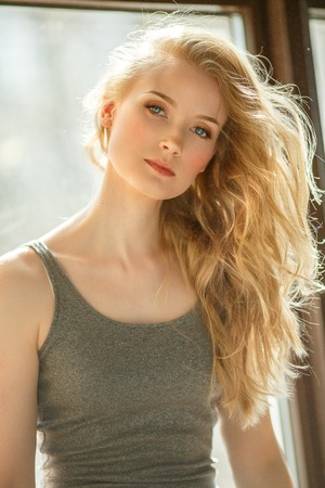 Photo pour Romantic blonde. Young beautiful cute woman. Beauty girl with long shiny hair, glowing skin and voluminous haircut - image libre de droit