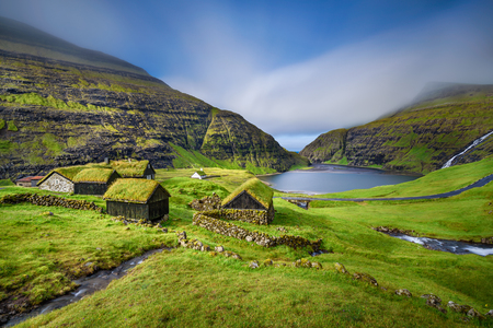 Photo for Village of Saksun located on the island of Streymoy, Faroe Islands, Denmark. Long exposure. - Royalty Free Image