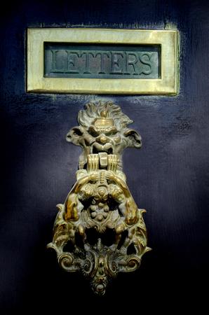 Photo pour Maltese door knob on dark wooden door in Valleta,Malta - image libre de droit