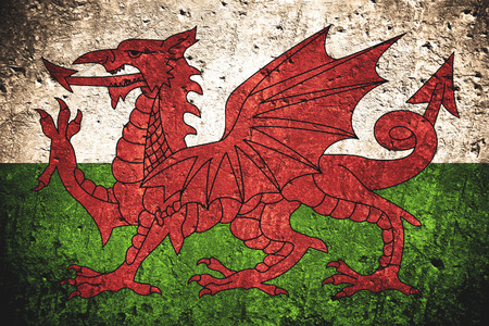 Photo for flag of Wales or Welsh banner on scratched rough texture - Royalty Free Image