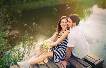 Foto de sensual romantic couple in love on pier at the lake outdoor in summer day, beauty of nature, harmony concept - Imagen libre de derechos