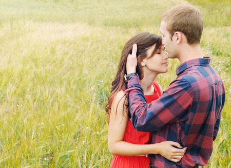 Photo for stunning sensual outdoor portrait of young stylish fashion attractive couple in love kissing in summer field - Royalty Free Image