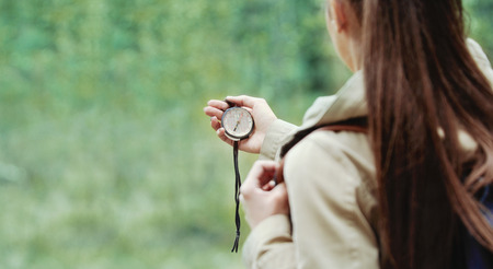 Photo for young woman discovering nature in the forest environment with compass, travel lifestyle concept - Royalty Free Image