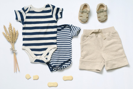Foto de top view fashion trendy look of baby clothes and toy stuff, baby fashion concept - Imagen libre de derechos