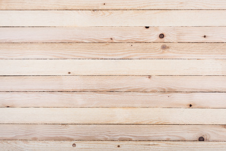 Foto de Wooden wall made of untreated planks, textured background image   - Imagen libre de derechos