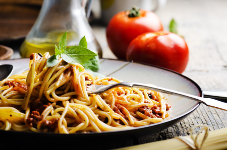 Photo for Italian spaghetti on rustic wooden table - Royalty Free Image