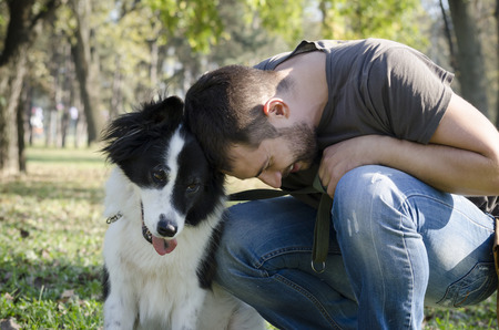 Photo for Man with his dog playing in the park - Royalty Free Image