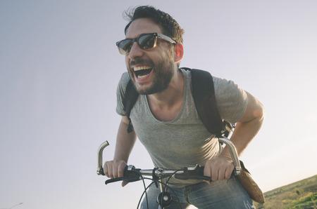 Photo pour Man with bicycle having fun. retro style image. - image libre de droit